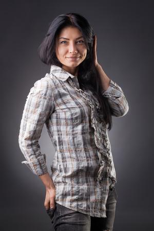 pretty woman model pose wear plaid shirt on the Gray studio background