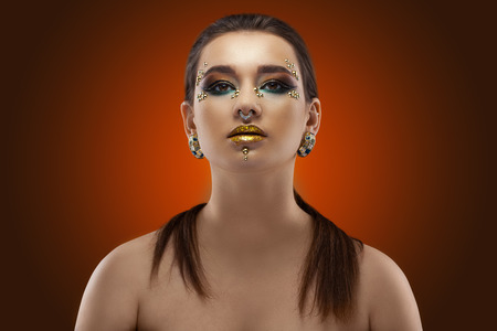 portrait of a girl. luxury shining makeup on the dark background Imagens