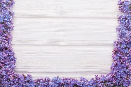lilac branches on the white wooden table Stok Fotoğraf