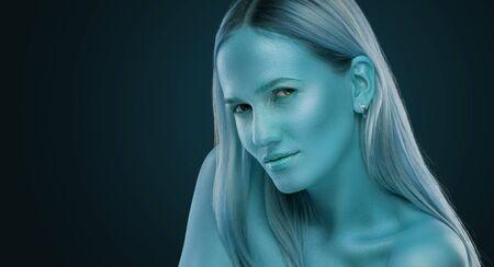 portrait of a girl. blue shining makeup on the dark background Stok Fotoğraf