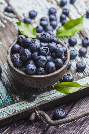 ripe blueberry berries on old wooden table