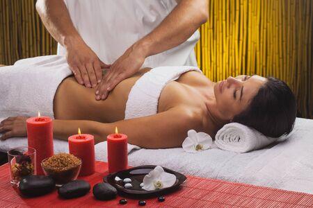 beautiful brunette woman in a massage salon