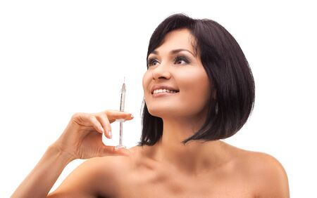 woman beautician with syringe on white background Archivio Fotografico - 133855132