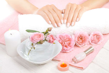 beautiful pink manicure with pink roses,manicure set, on the white and pink towels