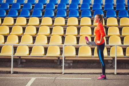 woman runner warm-up at the stadium