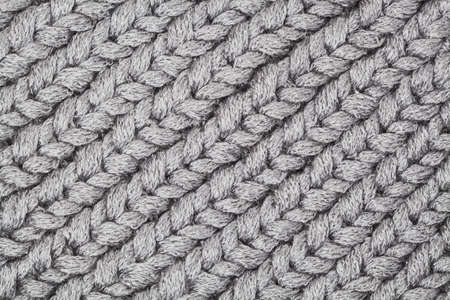 Gray knitting texture background.