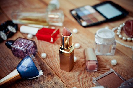 vanity: Various makeup products on wooden background