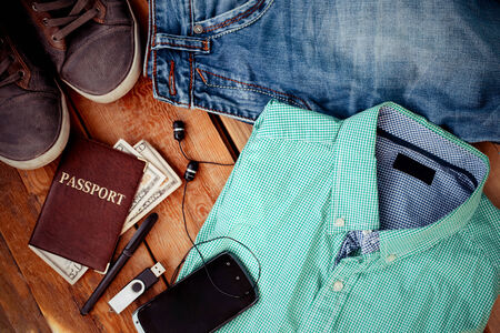 Man clothing and accessories on a wooden background photo
