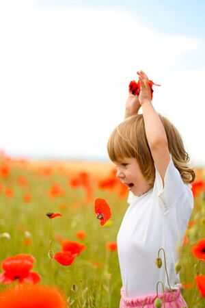 ttractive: Girl on meadow with a red poppies