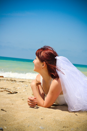 trash the dress: Young bride Stock Photo