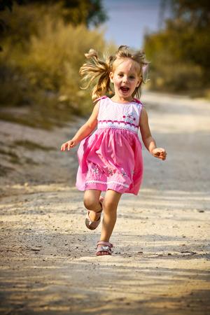 running open arms little happy girl green meadow field track Stok Fotoğraf
