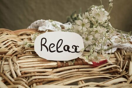 healthfulness: Tag with text relax on the white flowers Stock Photo