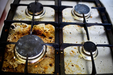Dirty filthy gas stove in kitchen