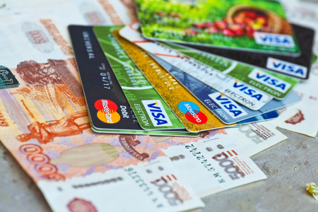 visa credit card: KIEV UKRAINE on June 15: Heap of credit cards Visas and MasterCard Ukraine on june 15 2015.Pile of Visa credit cards. Visa and master card is biggest credit card.