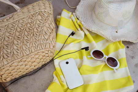 Straw hat , bag and sunglases a  Summer lifestyle. Bright colors. Vacation mood. Stock fotó