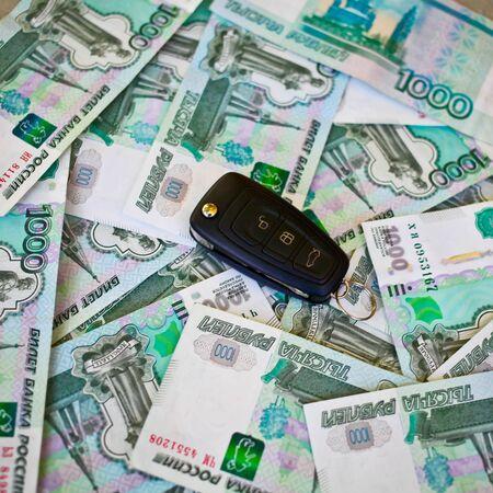 cash money: Car key laying on Russian cash money