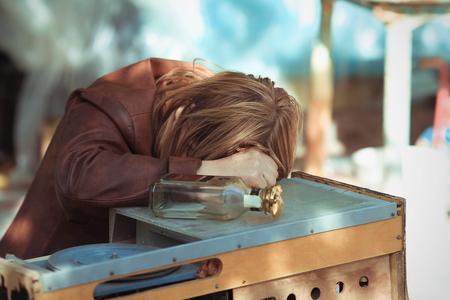 drunk girl: The drunk woman who fell asleep on a table on the street