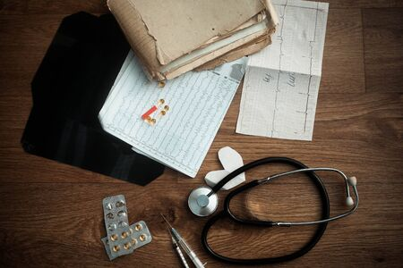 pharmacologist: Prescription form lying on table with stethoscope. Medicine concept.