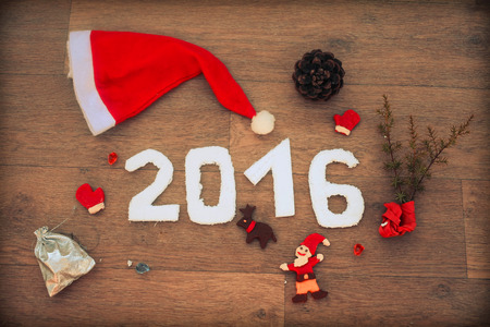 christamas: 2016 for New Year And Christmas design on  wooden table with fir leaves, Santas cap, the cone and decor from plasticine  Empty copy space for inscription Idea merry new year holiday year of monkey Stock Photo