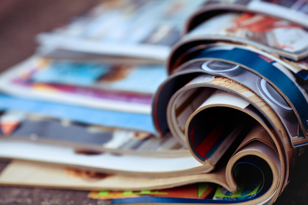 reviewing: Stack of magazines