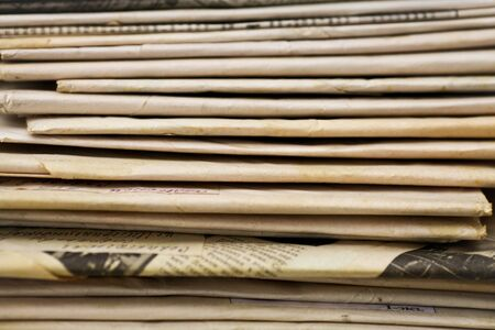 broadsheet newspaper: Newspapers folded and stacked
