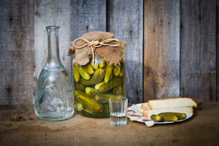 decanter: Vodka decanter, pickle and snack, image in the soft blue toning Stock Photo
