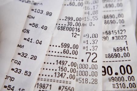 illustrating: Cash receipt illustrating the spent money Stock Photo