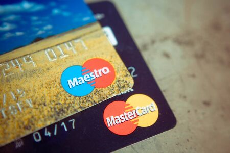 mastercard: SEVASTOPOL, RUSSIA - on  FEBRUARY 23,2016: Pile of MasterCard  and Maestro credit cards. Mastercard one of the two biggest credit card companies in the world.