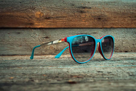 eyewear fashion: accessory, background, blue, chrome, classic, close-up, closeup, dark, design, elegance, eye, eyeglasses, eyesight, eyewear, fashion, fashionable, focus, fragility, frame, glass, imagery, lens, lumber, male, modern, object, old, old-fashioned, optical, pl