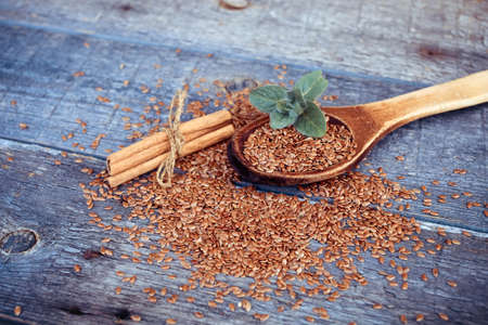 Flax seed and mint on a wooden background