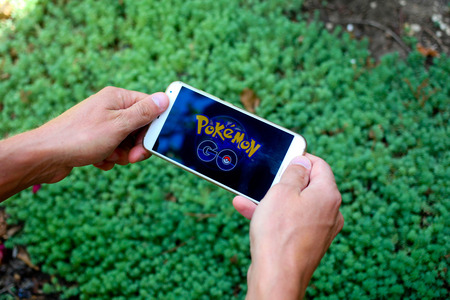 KRASNODAR, RUSSIA - on August 14, 2016 : Pokemon Go is a location-based augmented reality mobile game. Sajtókép