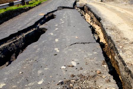 land slide: Destroyed by a landslide road Stock Photo