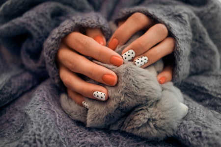 nail art and knitted sweater