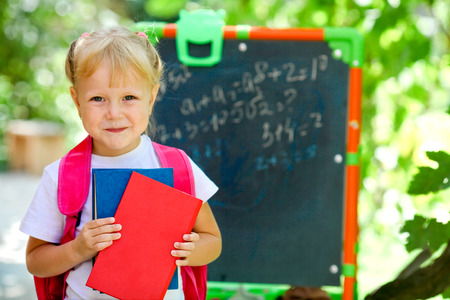 assignments: Adorable little schoolgirl feeling extremely excited about going back to school