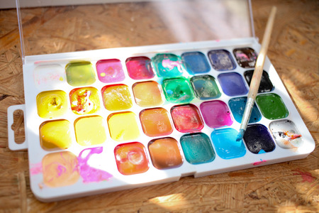 Watercolor paints with a brush . For childrens creativity Stock Photo