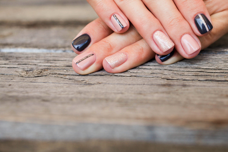 Female manicure with beautiful design the drawing (shellac). Reklamní fotografie