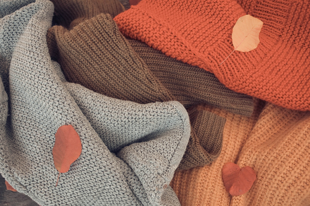 Warm knitted multi-colored autumn sweaters Reklamní fotografie