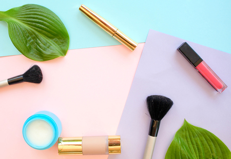 Accessories for a make-up on a multi-colored background .