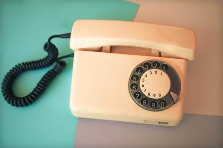 Telephone retro receiver over color background Stock Photo