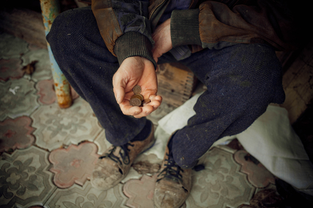 Male hand asks for money. The concept of poverty in the country. Banco de Imagens - 120733264