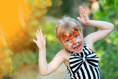 Portrait of funny girl with face painting