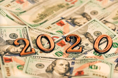 Gold numbers 2020 on a background of money dollars. New year concept Stok Fotoğraf