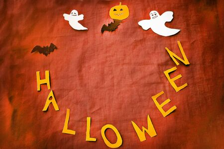 Halloween decoration over red background. Copy space
