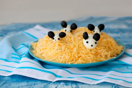 New Year 2020 - year of the white rat. Cute salad - white mouse on the cheese from eggs and olives