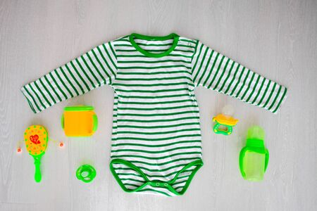 Children is clothing green color and accessories on the external background