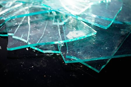 Broken glass pile pieces texture and black background , cracked window effect Stockfoto