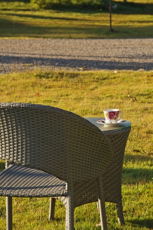 relaxing chair with a cup of coffee in Backyard Stock Photo