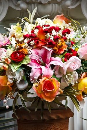 Bouquet of colorful flowers in the vase on the altar photo
