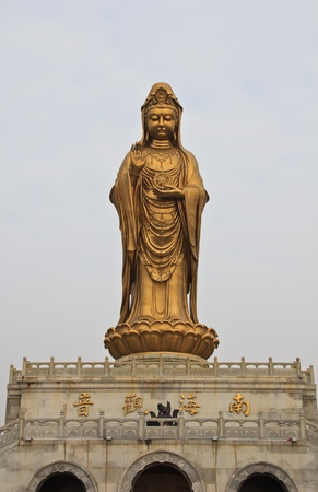 Guan Yin Statue wonderful, against Peaceful sky photo