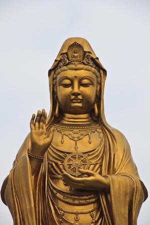 Guan Yin Statue wonderful, against Peaceful sky